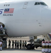 Malaysia MH17 bodies arrive home